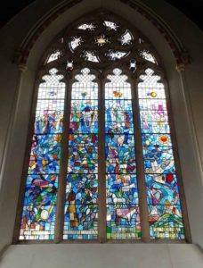 damaged stained glass in church before restoring
