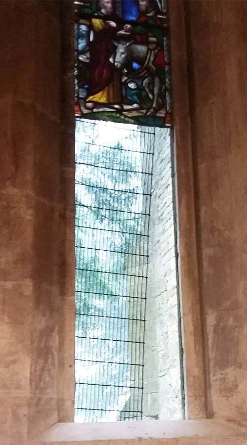 Before picture of stained glass window in a church