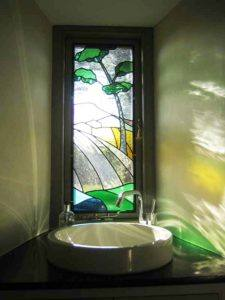 Newly made stained glass window in a bathroom