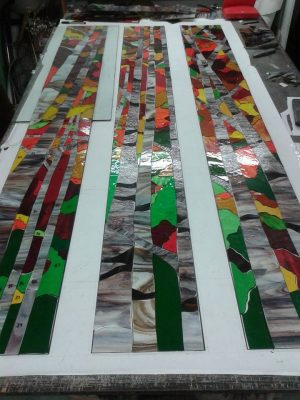 abstract orange and green long stained glass panels